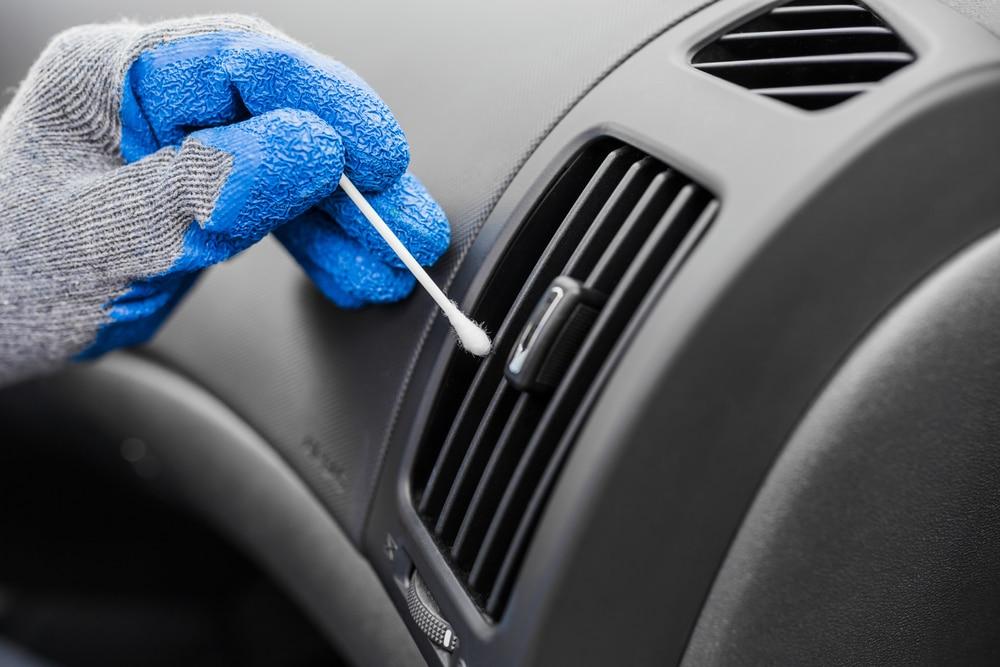 person swabbing car fan